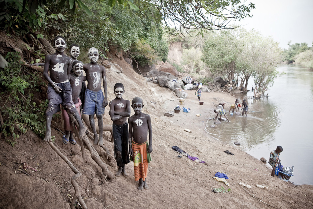 Boys with painted faces on the banks of the River Gambia Image ©Jason Florio