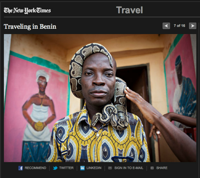 New York Times Travel - Benin - image of a voodon man with a python wrapped around his head . Image © Jason Florio