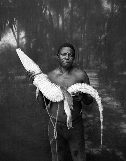 abdou ndong fisherman with a rescued crocodile 2007