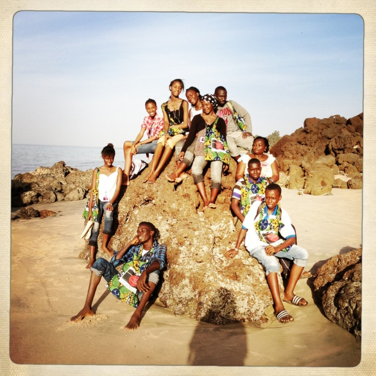 Gambian photography students show off their 'Photos Tell Stories'  Jekkah tote bags