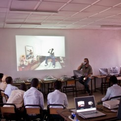 Florio shows the Farafenni students his Cuban hiphop body of work
