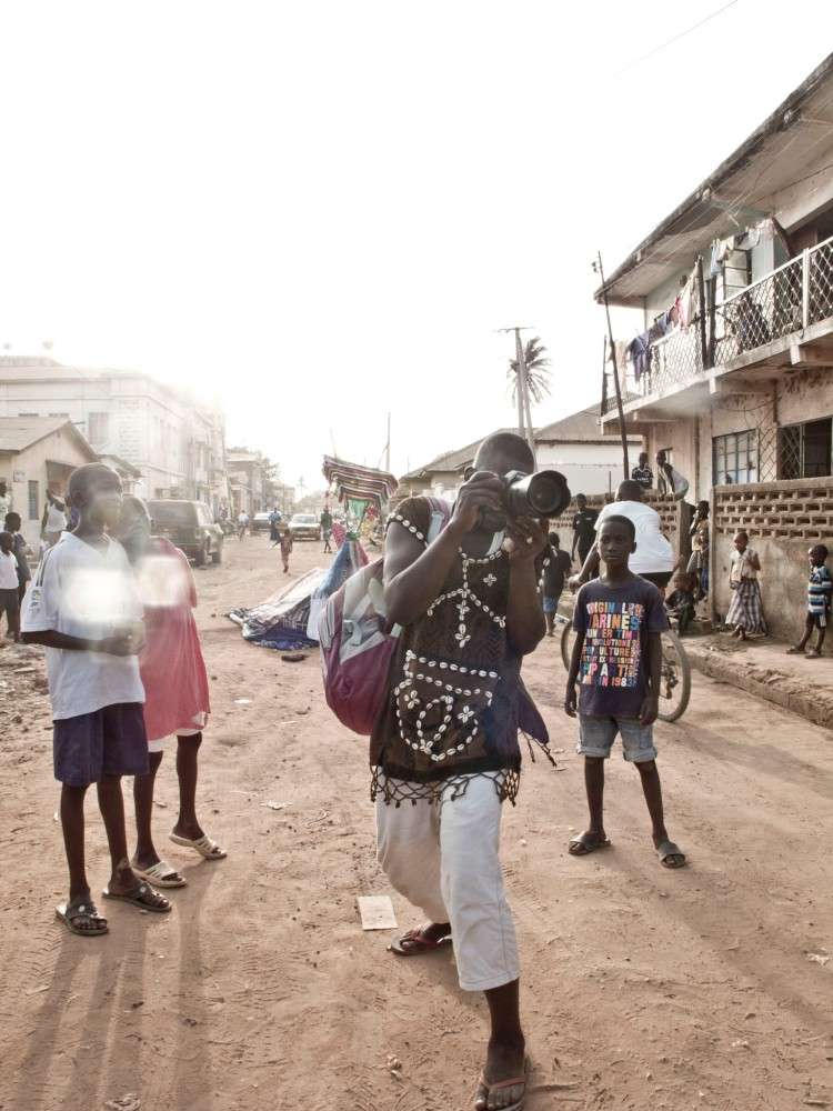 Jason's camera is loaned to a budding photographer - from a Malian masquerade group, Banjul, The Gambia