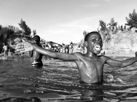 BOY LAUGHING RIVER GAMBIA