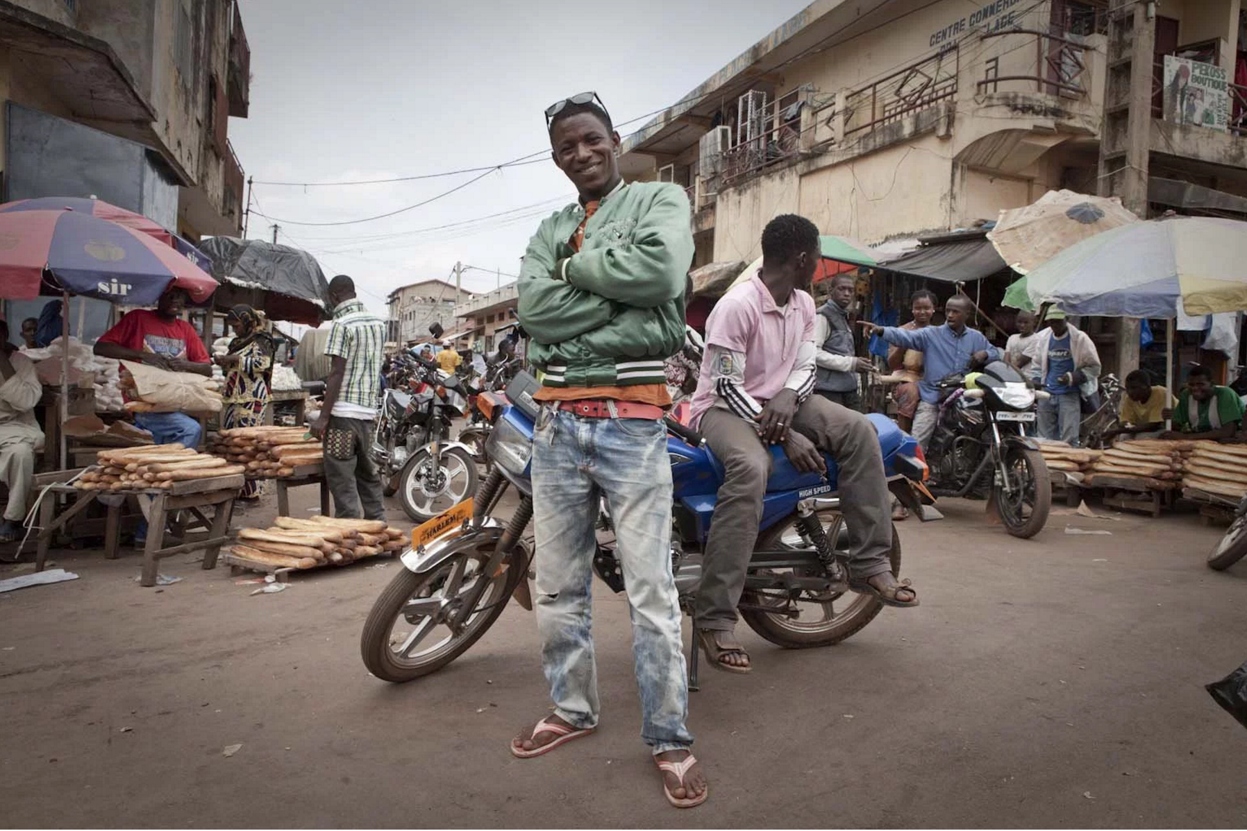 Moto Taxi Boys, Labé, Fouta Djallon, Guinea Conakry. Image ©Jason Florio from the River Gambia Expedition