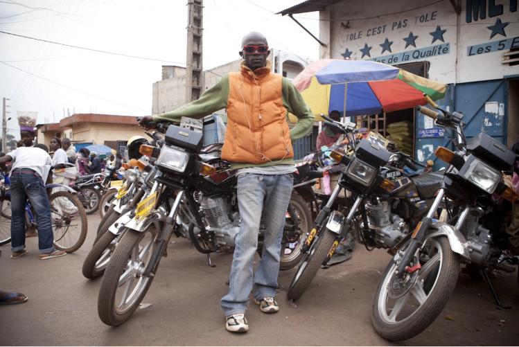 Moto Taxi Boys, Labé, Fouta Djallon, Guinea Conakry. Image ©Jason Florio from the River Gambia Expedition
