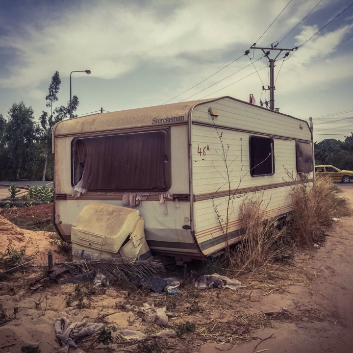 Abandoned caravan, Bertil Harding Highway, The Gambia, West Africa © Helen Jones-Florio