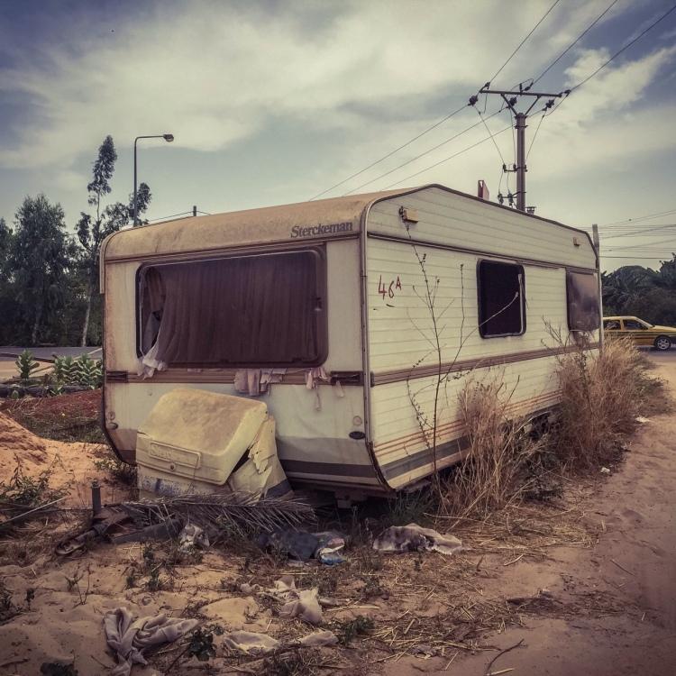 Abandoned caravan, Bertil Harding Highway, The Gambia, West Africa © Helen Jones-Florio