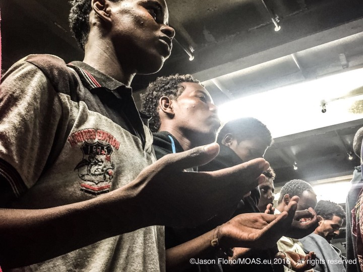 ERITREAN PRAYERS ON BOARD RESCUE BOAT © JASON FLORIO/MOAS.EU