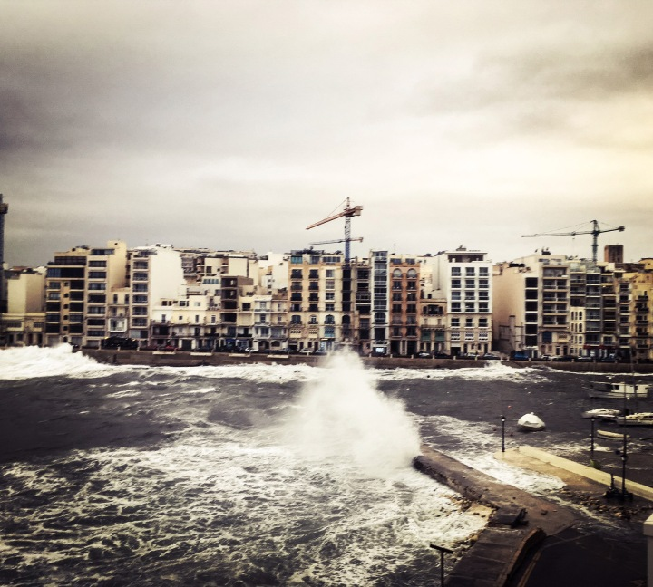 Waves crashing against the pier, Spinola Bay, St Julians, Malta © Helen Jones-Florio
