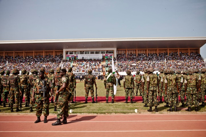 Gambian troops stand to attention, as they wait for the arrival of President Adama Barrow, Bakau Stadium © Helen Jones-Florio