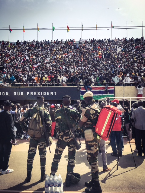 ECOWAS troops photograph the crowds, with their phones at Bakau Stadium © Helen Jones-Florio
