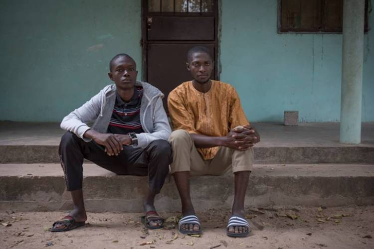 Repatriated Gambian, Mohammed, with his uncle, Alieu, The Gambia ©Jason Florio