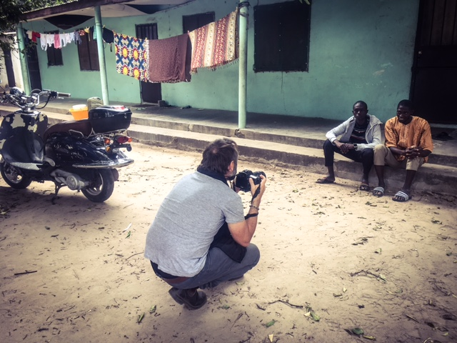 Jason Florio photographing repatriated Gambian, Mohammed, The Gambia © Helen Jones-Florio