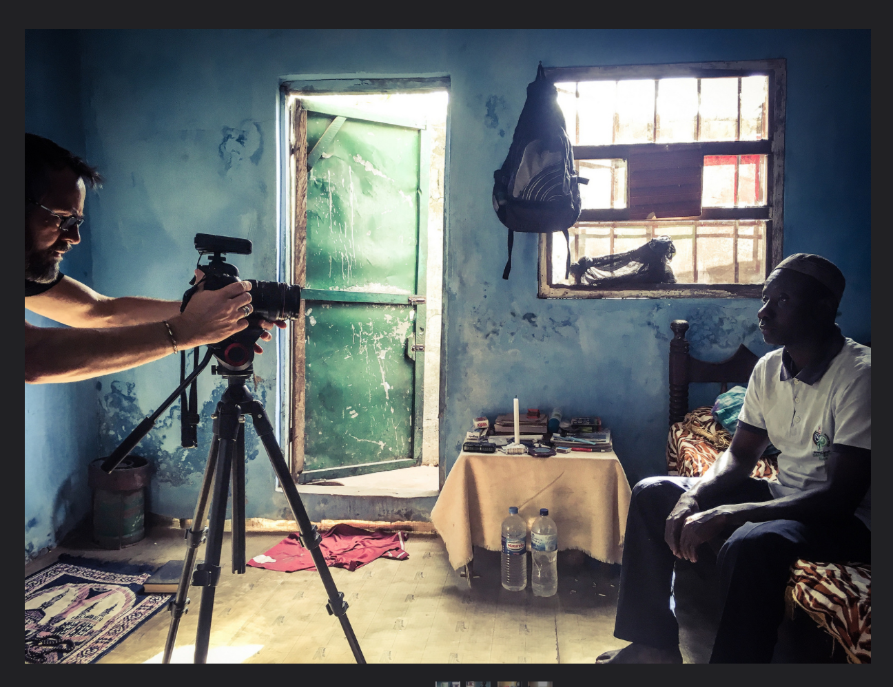 Photojournalist, Jason Florio, prepares to interview ex-Mile2 prisoner, Ballo, The Gambia, West Africa