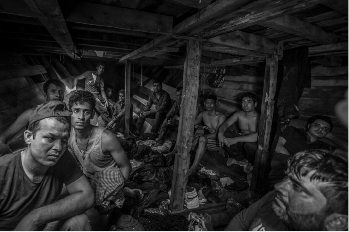 Bangladeshi and Pakistani migrants wait to be evacuated from the fetid hold of a smuggler's boat off the coast of Libya. © Jason Florio/MOAS. Photojournalism Series Winner, Magnum Photography Awards 2017.