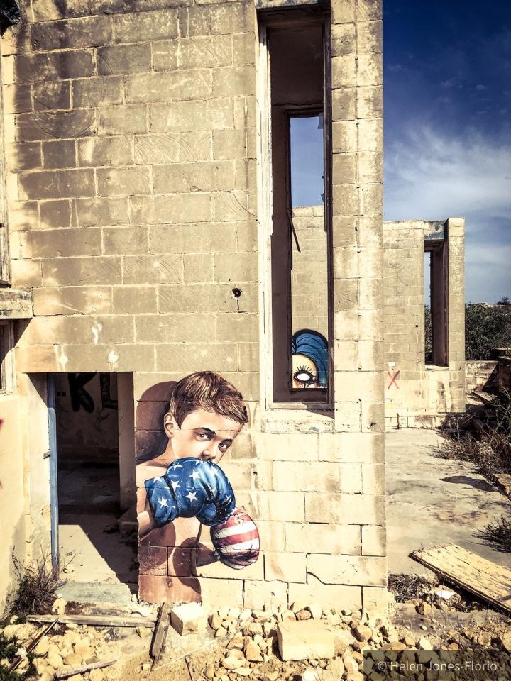'Peep Show' - Graffiti, Malta - American boxer boy ©Helen Jones-Florio