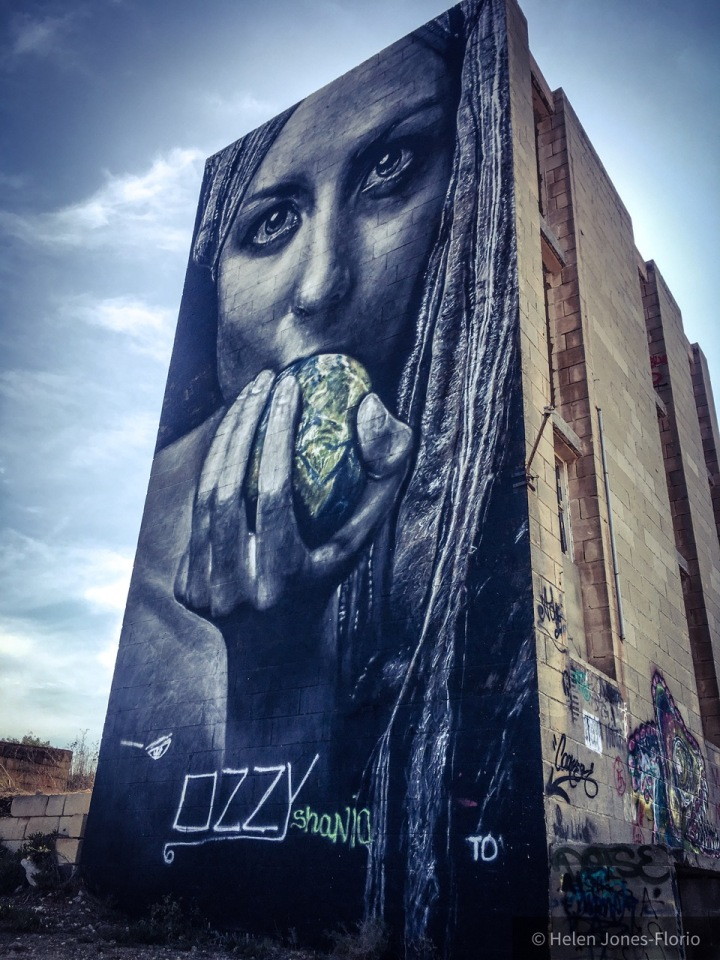 Graffiti mural, Malta - girl eats apple of the world ©Helen Jones-Florio