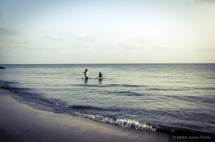 Jason Florio, filming, wading in the Atlantic Ocean, The Gambia ©Helen Jones-Florio