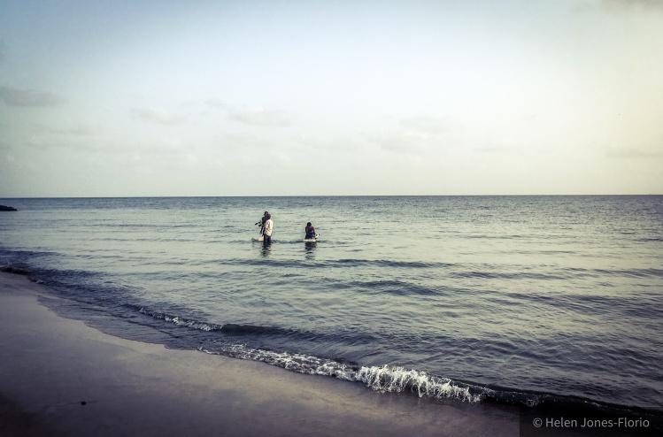Jason Florio, filming, wading in the Atlantic Ocean, The Gambia ©Helen Jones-Florio