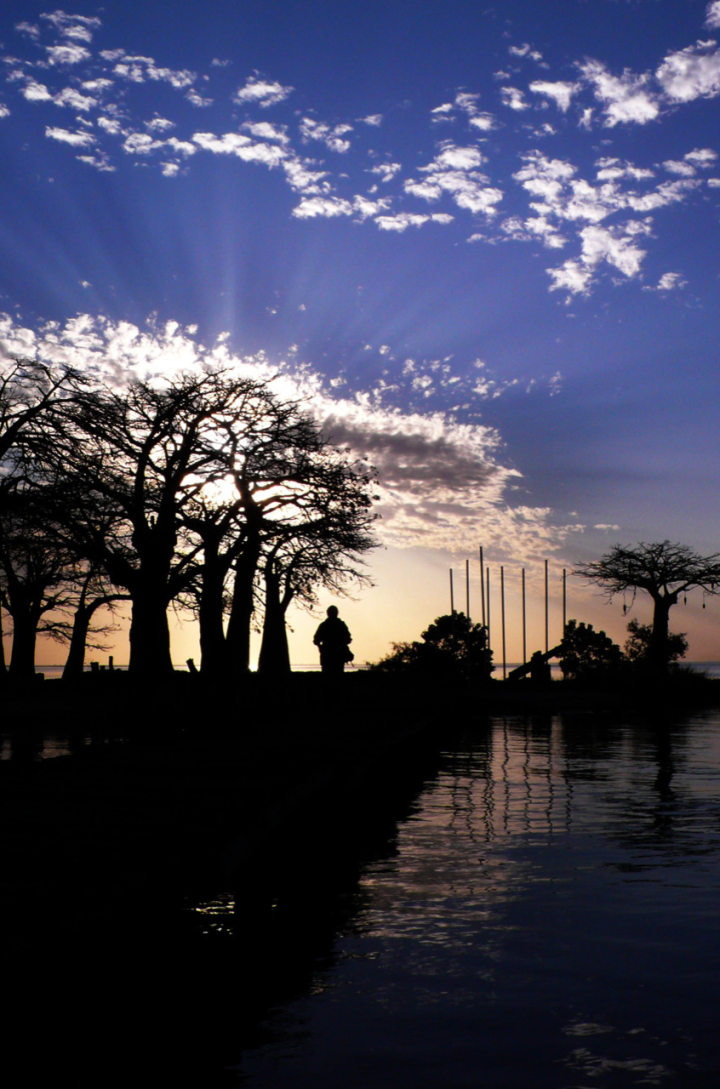 The sun sets over Kunta Kinte Island, River Gambia, The Gambia, West Africa © Helen Jones-Florio