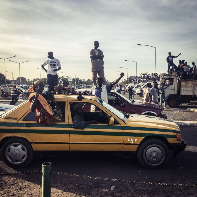 Gambian celebrate the return home of their new president, Adama Barrow ©Helen Jones-Florio