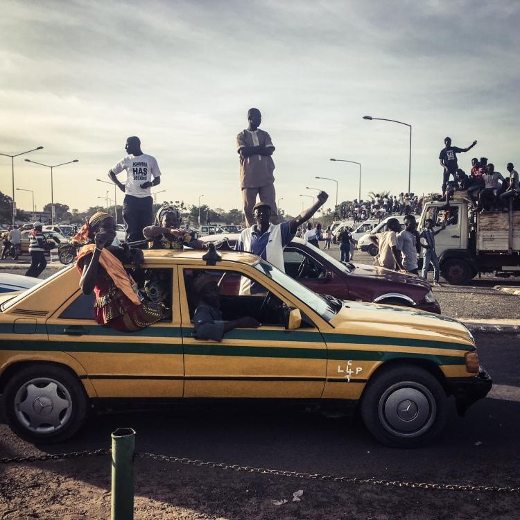 Gambian celebrate the return home of their new president, Adama Barrow ©Helen Jones-Florio