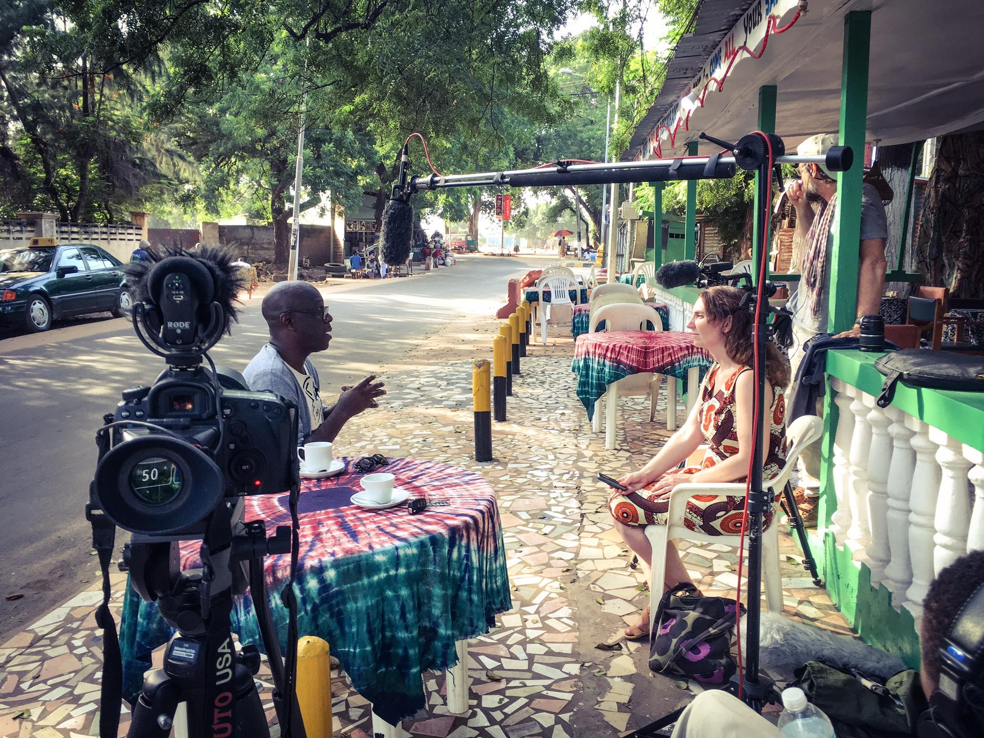 Louise Hunt, write and co-producer, interviews Salieu Taal (#GambiaHasDecided), Saffy J's Restaurant, Bakau ©Helen Jones-Florio