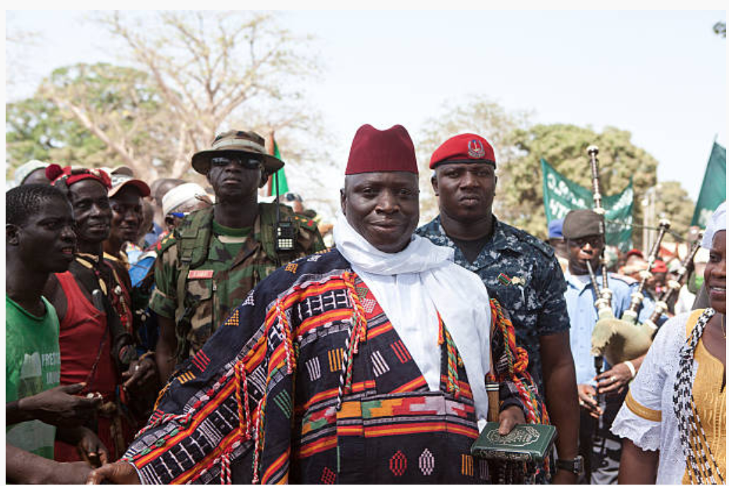 Ex-president, Yahya Jammeh, with his ever-present security force ©Jason Florio