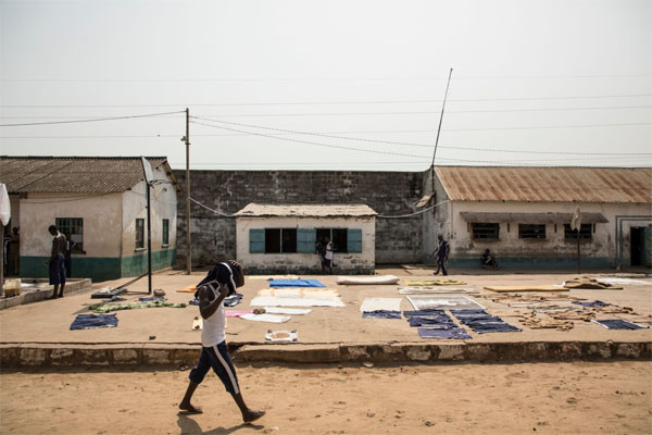 Exclusive images inside Mile 2 Prison, The Gambia - The exercise yard come laundry space - image © Helen Jones-Florio