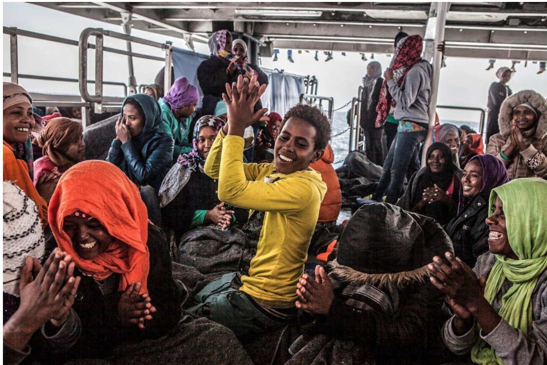 Unaccompanied minor, Eritrean, Henock, onboard rescue ship, leads refugees in song of thanks ©Jason Florio