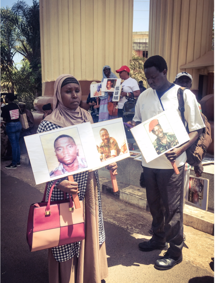A peaceful vigil by families of victims of Yahya Jammeh's regime, holding placards of their missing family members, The Gambia © Helen Jones-Florio