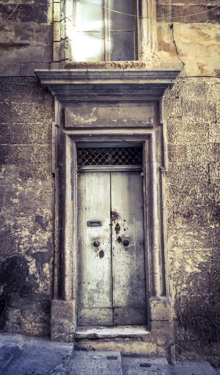 The door with 4 locks, Triq San Gwann, Valletta, Malta ©Helen Jones-Florio