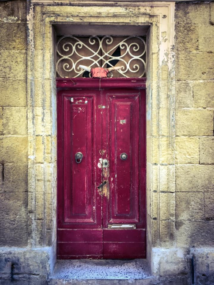 Old red doors of derelict house, Sqaq Santa Liena, Bormla, Malta ©Helen Jones-Florio
