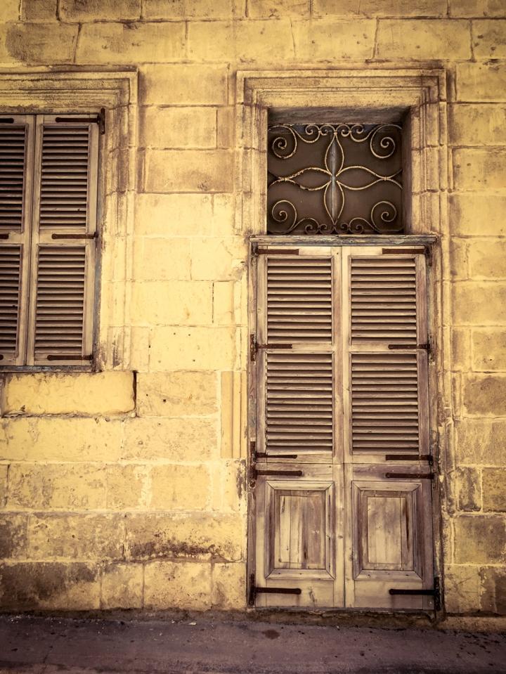 Shuttered doors and windows, facade of derelict house, Triq Felic, Bormla, Malta ©Helen Jones-Florio