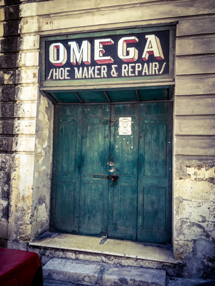 'Omega' Vintage storefront/shop front doors, shoemakers and repairs, Triq San Frangisk, Bormla, Malta ©Helen Jones-Florio