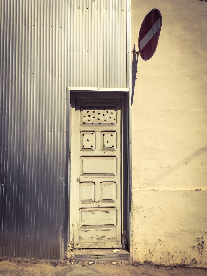 Target practice? Old wooden door with bullet holes(?), Triq San Gwan Battista, Sliema, Malta ©Helen Jones-Florio
