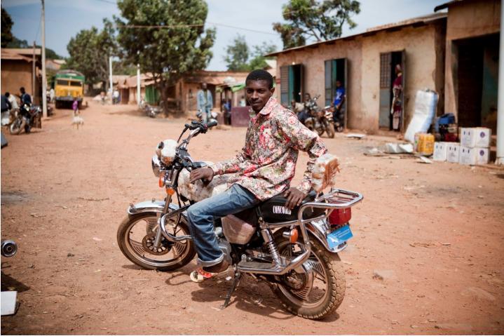 River Gambia Expedition: Moto Taxi rider, Ebu, Mali Ville, Fouta Djallon Highlands, Guinea-Conakry © Jason Florio