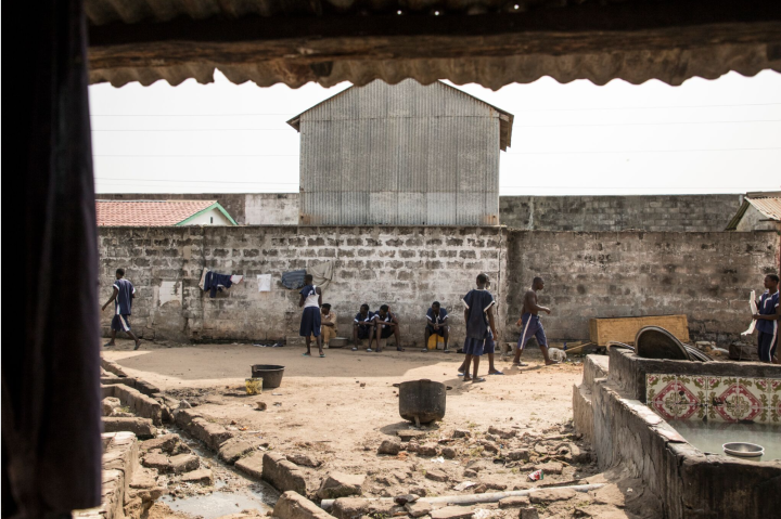 Exclusive images from Inside the notorious Mile 2 Prison, The Gambia   – prisoners in the main exercise yard of the prison  – image ©Helen Jones-Florio