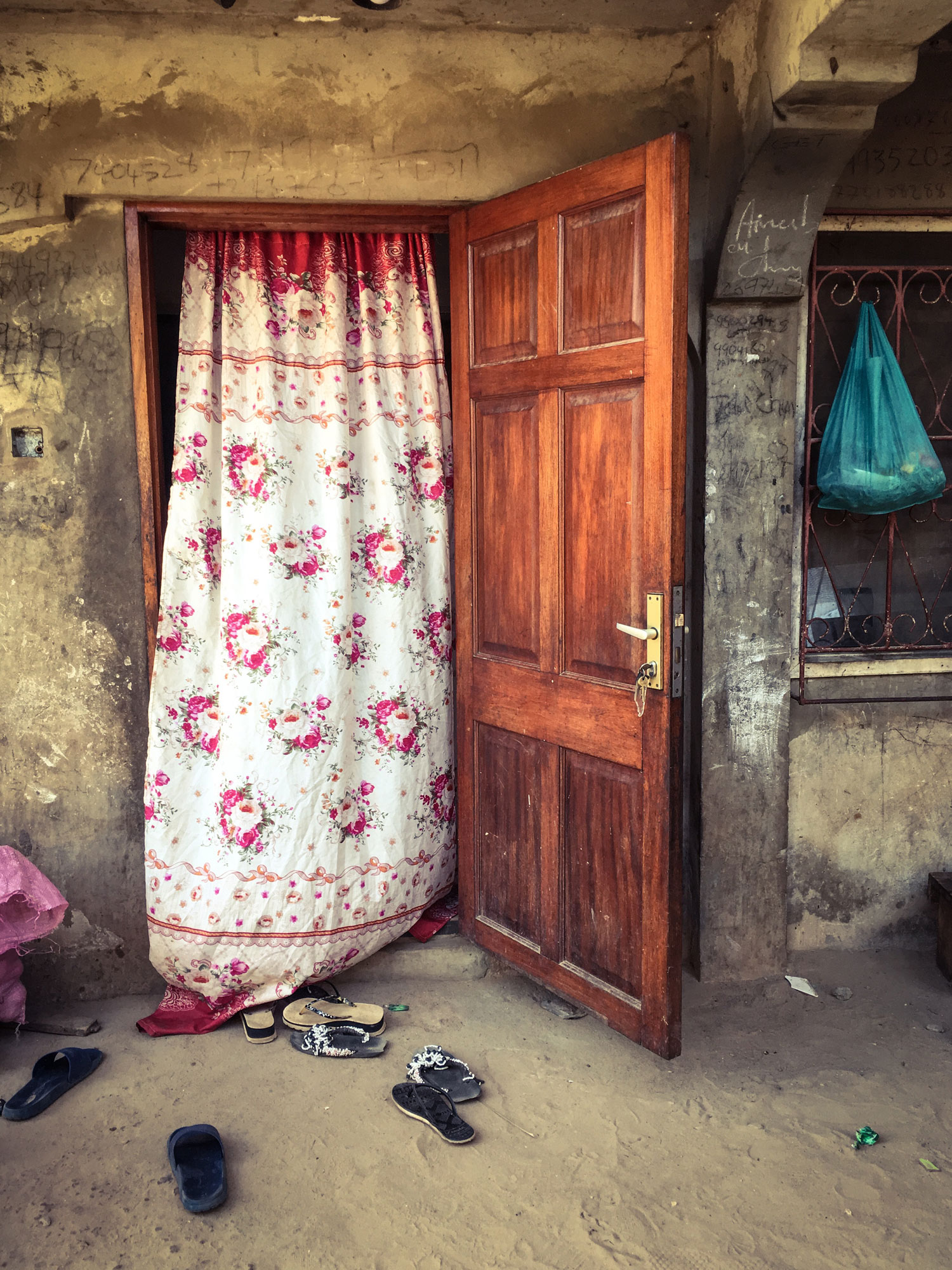 Stories Behind Doors, The Gambia, West Africa - the doorway to Mr. Chune's home. His 14 year old son was shot dead by Gambia security forces April 10th, 2000 © Helen Jones-Florio