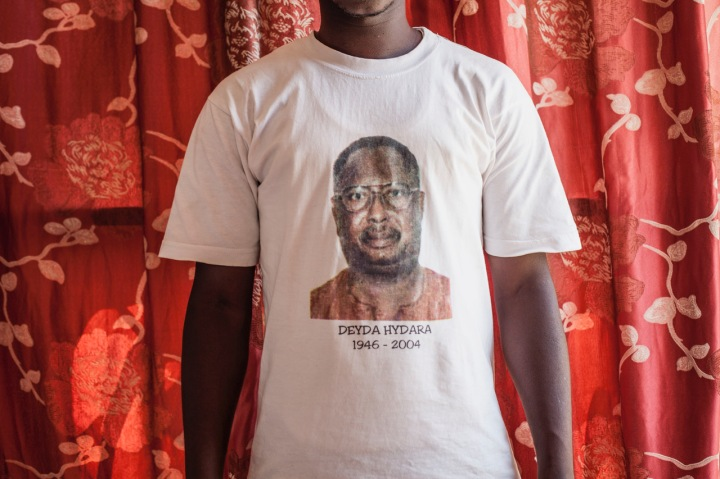 Gambia - victims and resisters: portrait of a man wearing a t-shirt with a photo of murdered newspaper editor and journalist, Dedyra Hydara ©Jason Florio