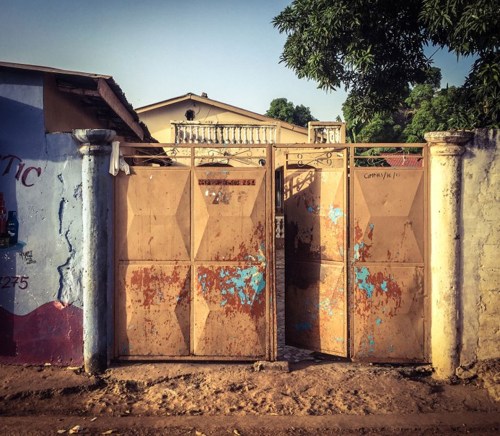 The gate to the compound of the late Omar Barrow, shot dead by Gambian security forces in 2009. Image © Helen Jones-Florio