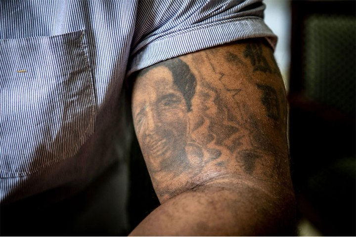 Baba Hydara with the tattoo of his murdered father, Gambia newspaper editor, and journalist, Deyda Hydara, on his arm © Jason Florio