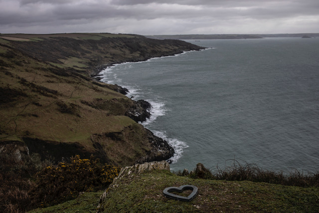 (self) Isolation - image © Jason Florio - a lone stone-shaped heart, on a clifftop, overlooking the sea, Cornwall, UK