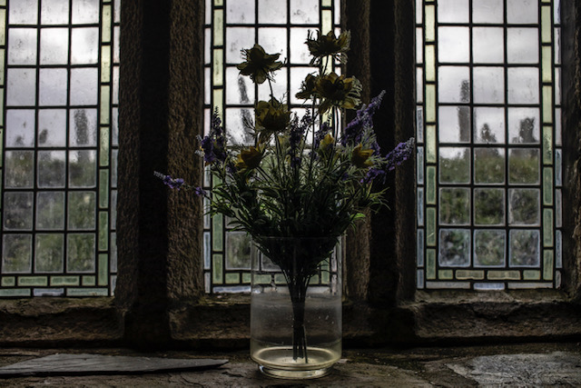 (self) Isolation - image © Jason Florio - a vase of flowers on the window ledge in an ancient country church, Cornwall, UK