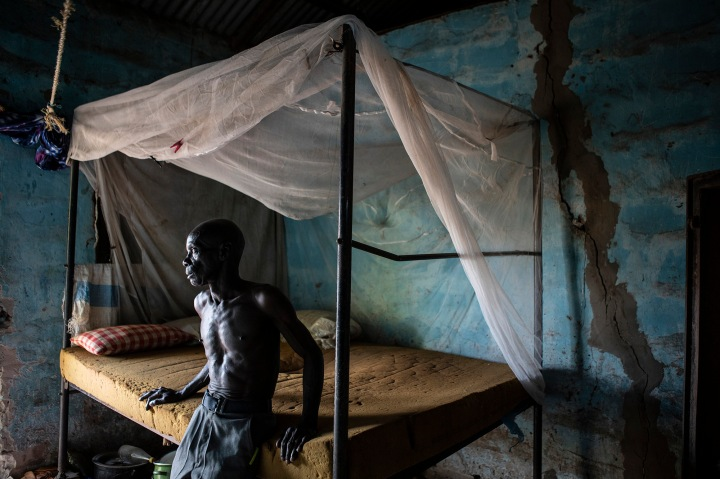 The Witch Hunts of 2009, The Gambia. TRRC Digest  Edition 10. Dodou Sanyang stands beside the bed of his late mother, The Gambia Image © Jason Florio/Helen Jones-Florio