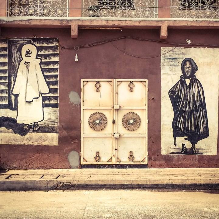 #GambiaDoors: Doors & Storefronts - The Gambia, West Africa. Mural's depicting the Mouride Brotherhood's, Lamp Faal and Baye Faal.