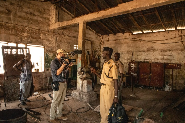 Photographer/filmmaker, Jason Florio filming inside the notorious Mile 2 Prison, The Gambia, West Africa. Image © Helen Jones-Florio