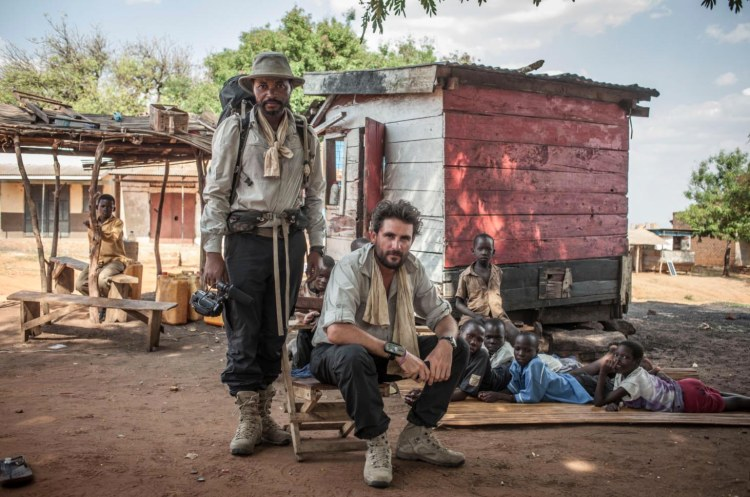 Portrait of British explorer Levison Wood with his walking partner Boston Beka during Wood's attempt to walk the length of the Nile from source to sea, Pawor village, Uganda. Image ©Jason Florio