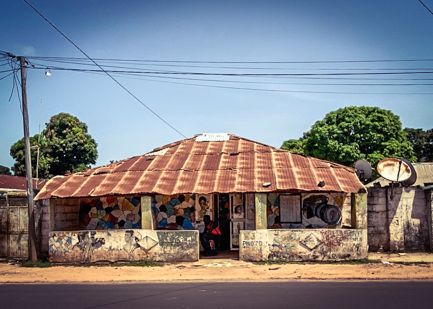 Gambia Doors: a local photography studio, with hand painted signs - in a suburban setting. Image ©Helen Jones-Florio
