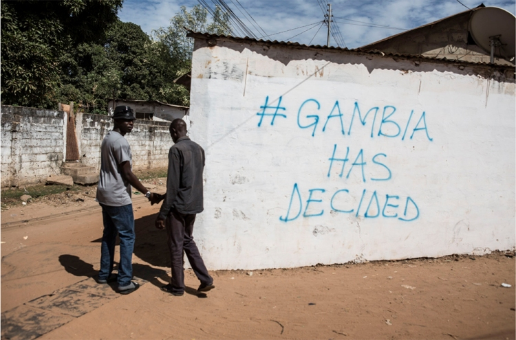 #GambiaHasDecided sprayed on a wall in urban Bakau, The Gambia, West Africa. Image © Jason Florio, 2017